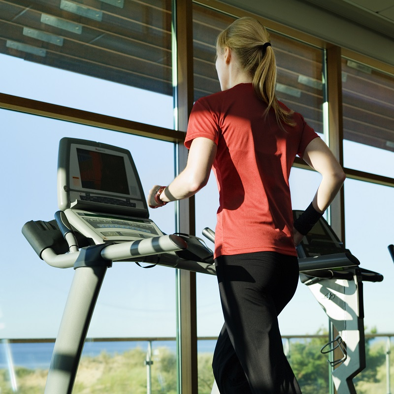 Woman running indoors at a gym